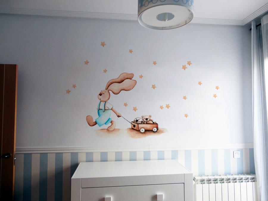 VINILO INFANTIL: Conejito con carro de juguetes y estrellitas beige
