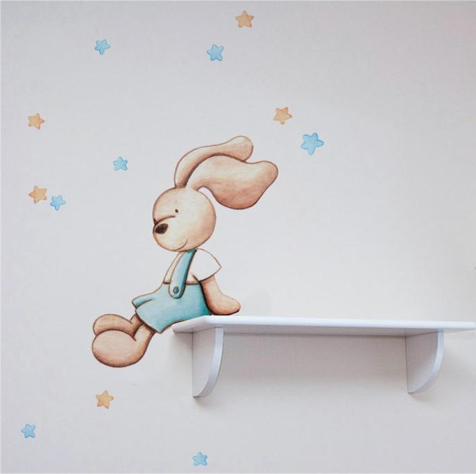 VINILO INFANTIL: Conejito sentado en azul