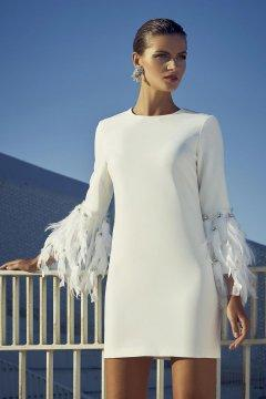 vestido-carla-ruiz-blanco-plumas.jpg