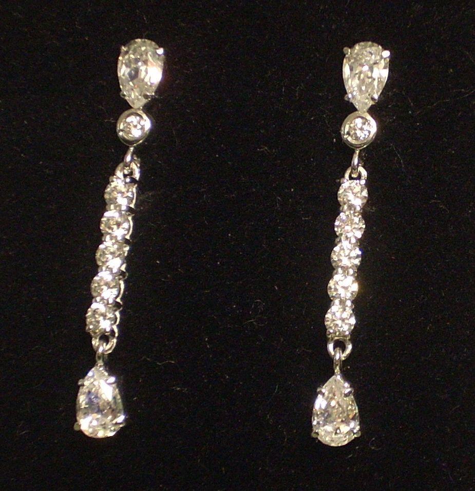 Pendientes largos oro blanco 18 quilates Circonitas Ideal novias