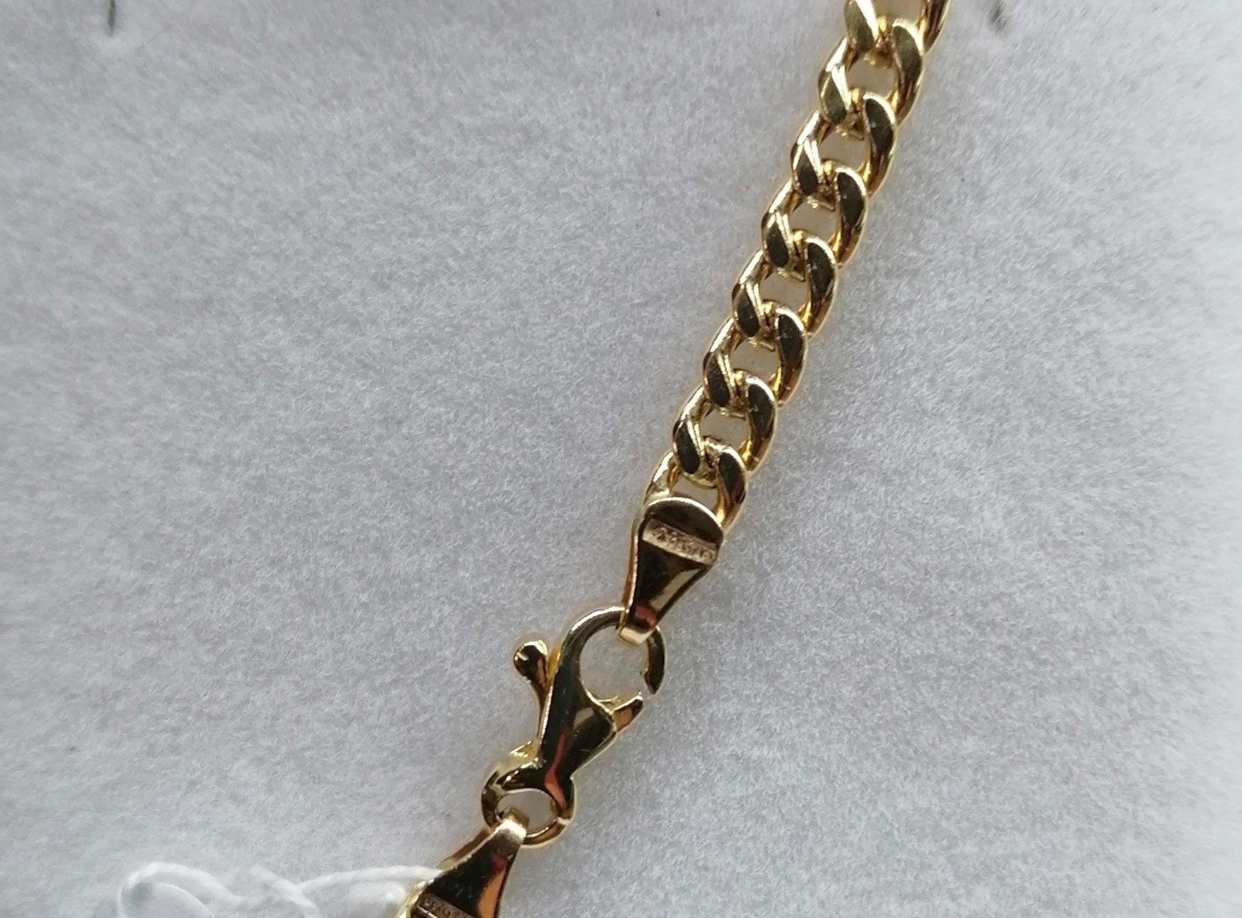 Broche de esta cadena de oro barbada semi hueca