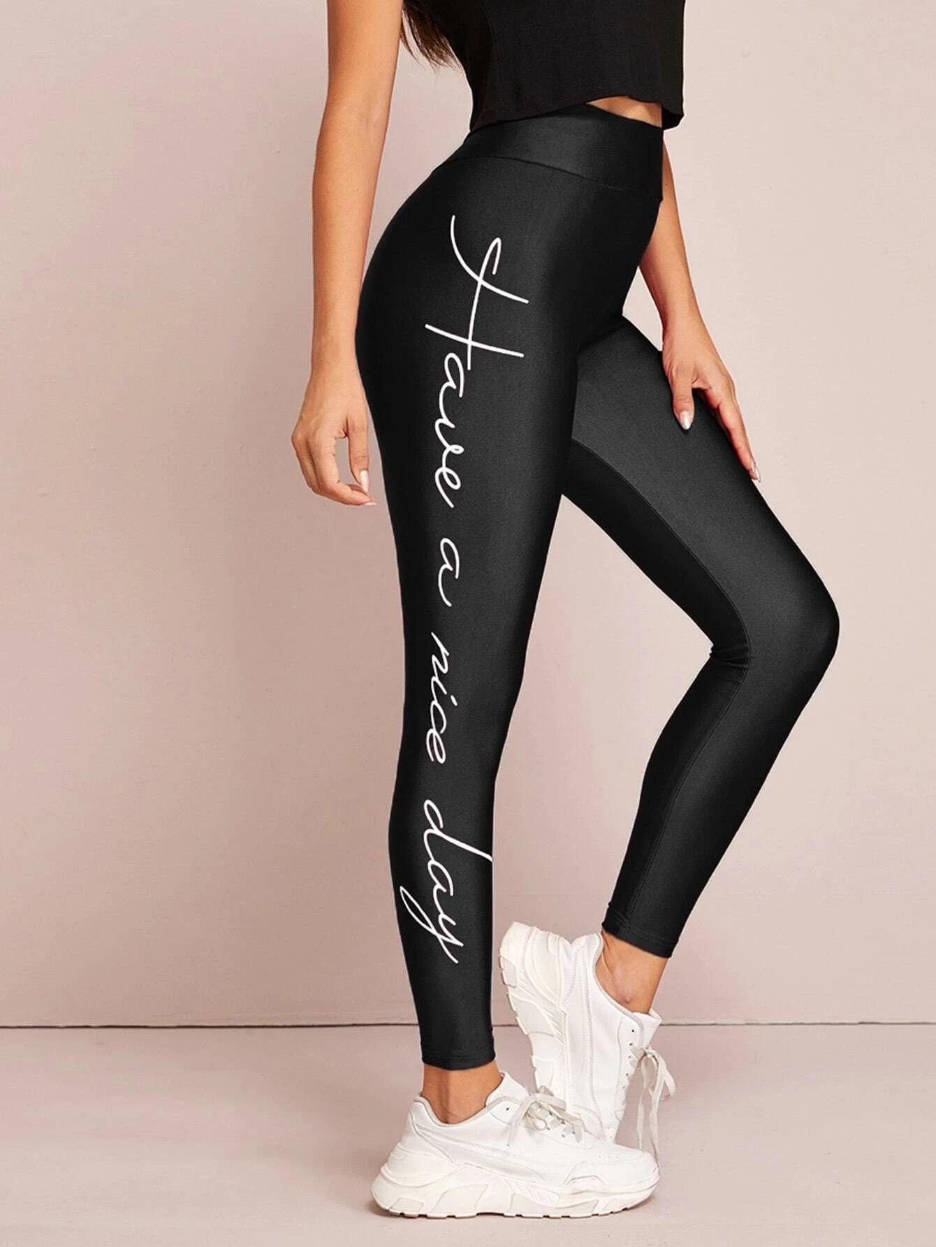 Leggings con slogan y dibujo de cintura con banda ancha