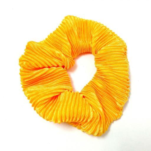 Coletero tela raso plisada amarillo