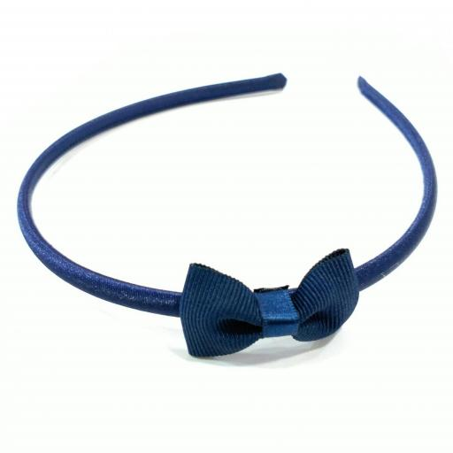 Diadema forrada con lazo azul marino [0]
