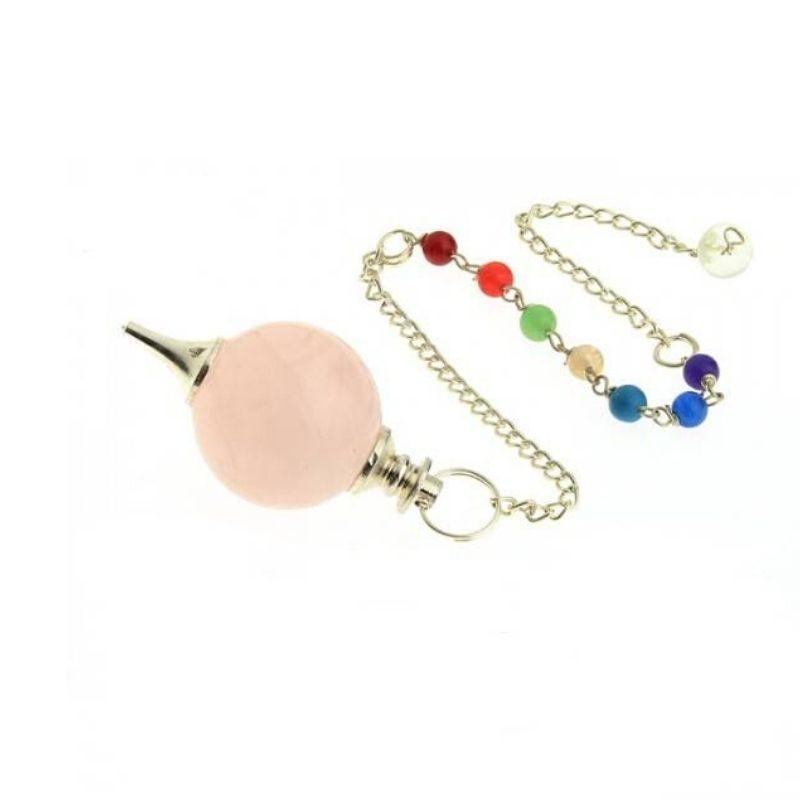 Péndulo mineral de cuarzo rosa con chakras
